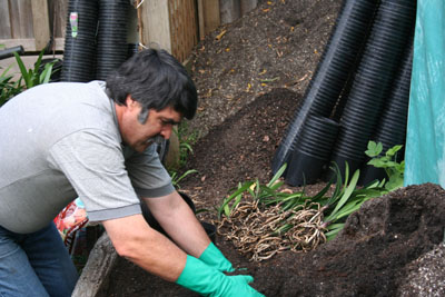 2- cover the drain holes with potting mix
